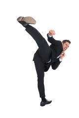 Businessman Kicking Over White Background