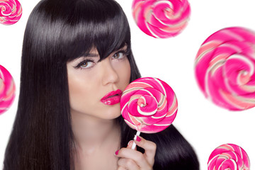 Attractive pretty girl with pink lips holding lollipop over swee