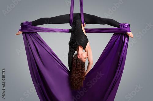 Fotobehang Luchtsport Beautiful dancer on aerial silk, aerial contortion, aerial ribbo