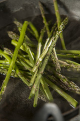 Asparagus spears, ready to be cooked in a pan.