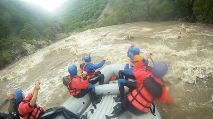 River Rafting as extreme and fun sport, splashing the waves.