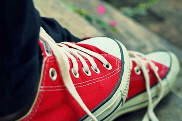 Red shoes on a wooden floor - Sneakers.
