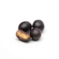 peanuts in chocolate on the white background