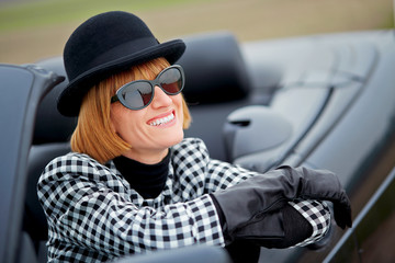 40s woman happy with new Convertible