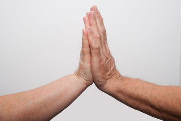 Two old hands pray