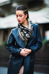 Beautiful portrait of rock woman model in leather jacket with da