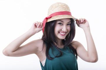 Yong girl hold fashion hat