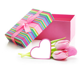 Pink tulips bouquet with greeting card and present box