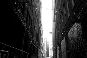 Downtown Brick Building Alley Way with lights