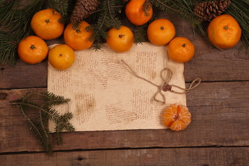 New Year's still-life with tangerines and a fur-tree branch