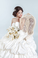 Beautiful bride model girl wearing in wedding dress with volumin