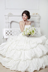 Beautiful attractive bride in wedding luxurious dress with volum