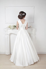 Bridal hairstyle. Beautiful charming bride in wedding luxurious
