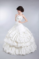 Beautiful attractive bride model wearing in wedding dress with v