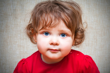 Adorable little girl with big blue eyes