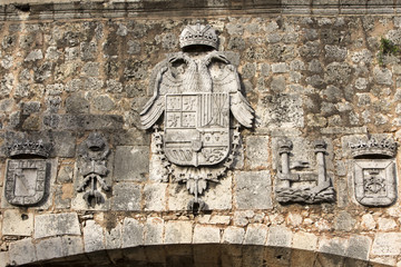 Emblems in San Diego gate, Santo Domingo, Dominican Republic