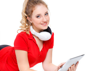 Girl listening to music on a tablet computer.