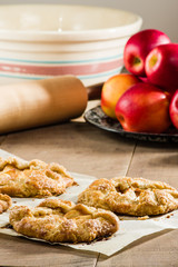 Vertical of apple tarts and apples