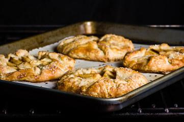 Apple tarts on a baking tray