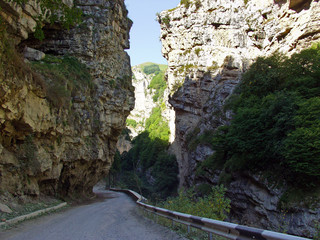 Winding asphalt road in a mountain gorge