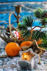 decorations with Christmas tree,candles and tangerines