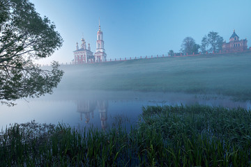 Landscape with two churches and foggy river