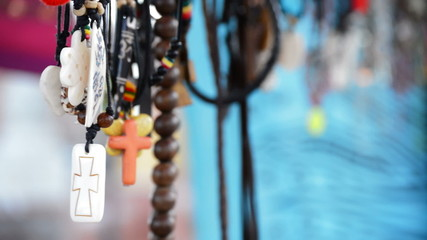 Hippies and tribal necklaces hanging in stall hawking crafts