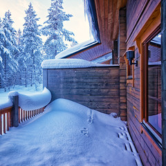 Terrace under snow in forest cottage