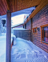Terrace under snow in forest cottage2