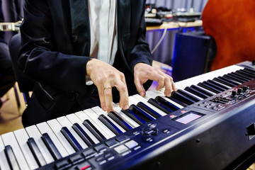 Pianist playing on digital piano