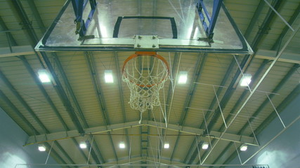 Basketball player scoring a 3 point jump shot