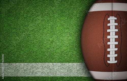 Leinwandbild Motiv American Football Ball on Grass