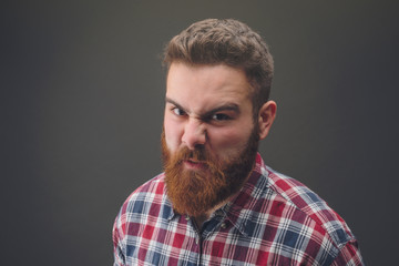 Angry bearded man portrait