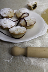 Christmas mince pies with red ribbon