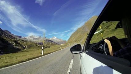 Car point of view driving on mountain pass road