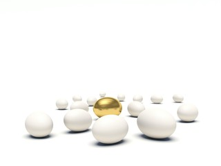 White eggs lying on the ground with golden egg among them.