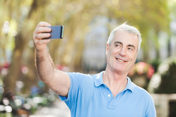 Senior Man Taking a Selfie at Park