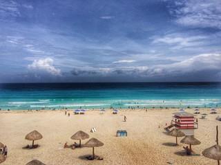 contrast among sky, ocean and beach