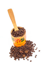 Many aromatic coffee beans and few anise stars in a wooden morta
