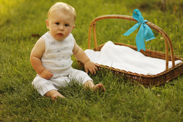 little boy near the basket to nature