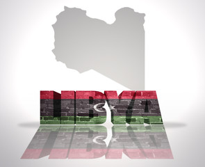 Word Libya on a map background