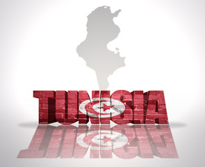 Word Tunisia on a map background