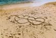 Hearts on sand near ocean