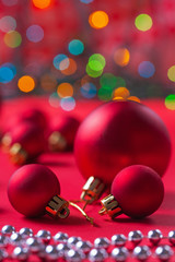 composition of red christmas balls on red table