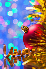 copyspace image christmas background red bauble and tinsel on bo