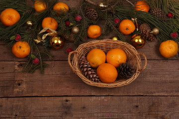 Still-life with tangerines and spheres and fur-tree branches