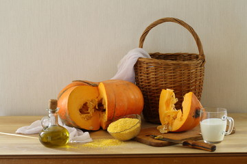 Still-life with a pumpkin, groats and milk and a wattled basket