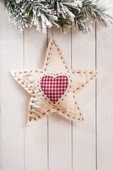 Christmas decorations in the shape of star on wood background