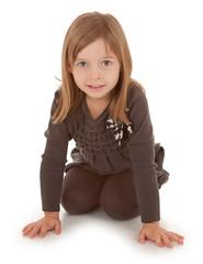 3 Year Old Girl Crawling and Smiling at the Camera
