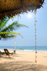 Untouched tropical beach with palms and fishing boats in Sri-